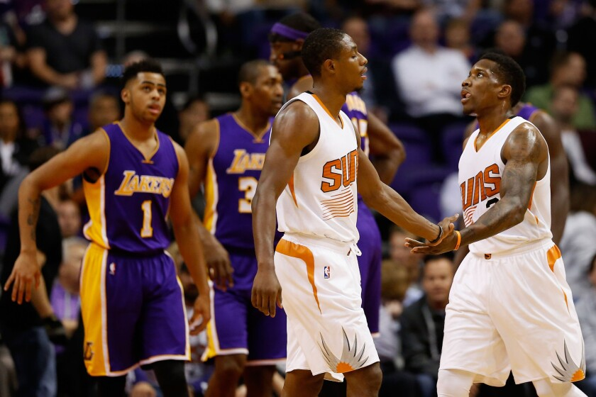 Suns guard Eric Bledsoe celebrates with teammate Brandon Knight after scoring against the Lakers during a Nov. 16 game in Phoenix.