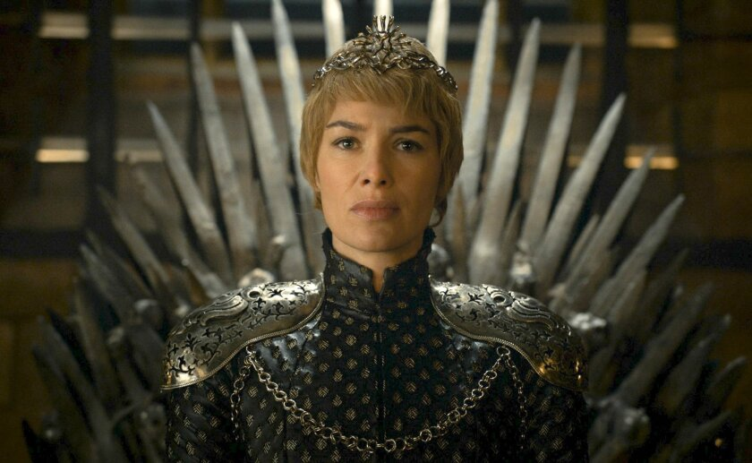 """In this image released by HBO, Lena Headey appears in a scene from """"Game of Thrones."""" This week's Comic Con  extravaganza is expected to draw more than 160,000 fans for high-energy sessions featuring casts and crews from such films and TV shows as """"Game of Thrones,"""" """"Star Trek,"""" """"Suicide Squad,"""" """"S"""