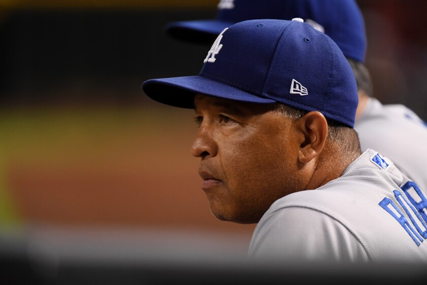Dodgers manager Dave Roberts looks on during a game against the Arizona Diamondbacks on Aug. 30.