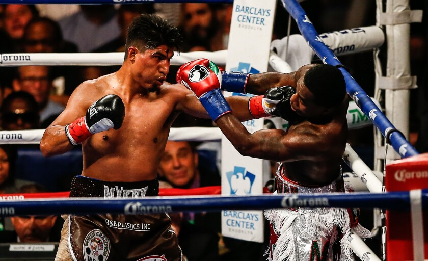 Mikey Garcia, left, and Adrien Broner exchange punches during a bout in 2017 at the Barclays Center in Brooklyn.