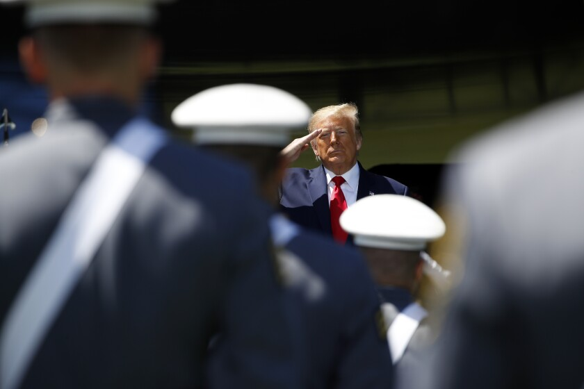 President Donald Trump salutes to the Class of 2020 at the United States Military Academy in West Point, N.Y.