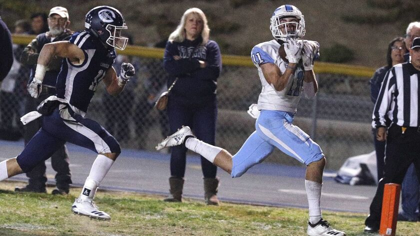 Corona Del Mar's Bradley Schlom makes a second quarter catch for a touchdown against Camarillo in th