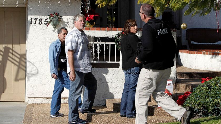 In this 2011 file photo, investigators with the San Diego County District Attorney's Office raid the home of a Sweetwater Union High School District board member as part of a political corruption case.