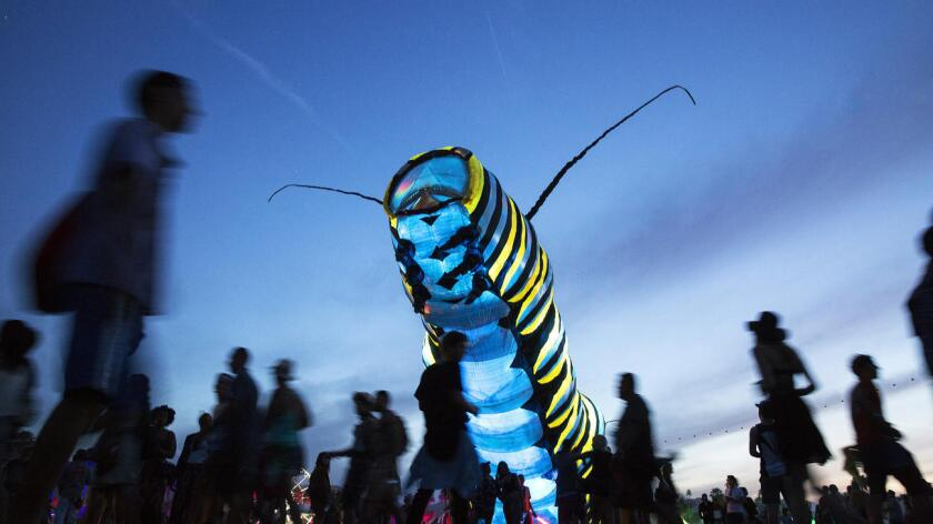 Poetic Kinetics' giant caterpillar moves between venues at the 2015 Coachella Valley Music and Arts Festival. Organizers said this year's art installations will be bigger and more elaborate than in years past.