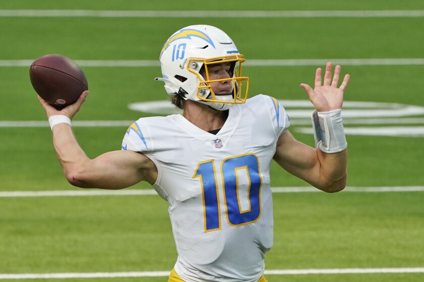 Los Angeles Chargers quarterback Justin Herbert throws against the Carolina Panthers during the second half of an NFL football game Sunday, Sept. 27, 2020, in Inglewood, Calif. (AP Photo/Ashley Landis)