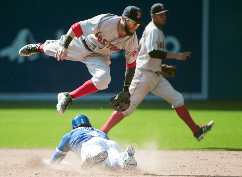 Toronto Blue Jays' Ezequiel Carrera, bottom, steals second base under Boston Red Sox second baseman Dustin Pedroia during the ninth inning of a baseball game in Toronto, Saturday, May 28, 2016. Carrera advanced to third on an error on the play. (Nathan Denette/The Canadian Press via AP) MANDATORY C