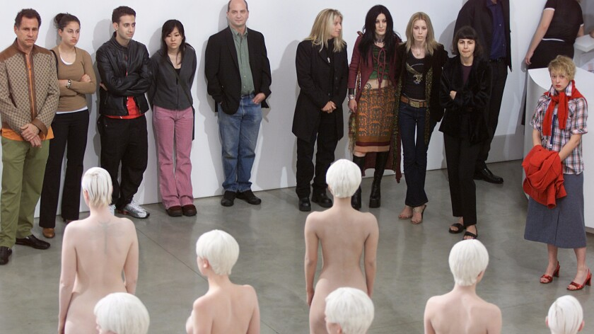 Viewers observe a Vanessa Beecroft performance at Gagosian Gallery in Beverly Hills in 2001.