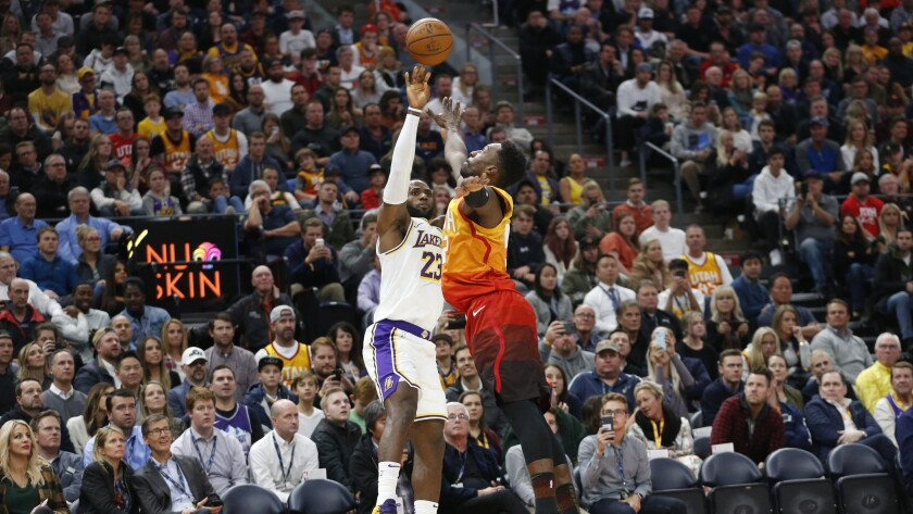 LeBron James puts up a shot over Jazz forward Jeff Green during a game Dec. 4.