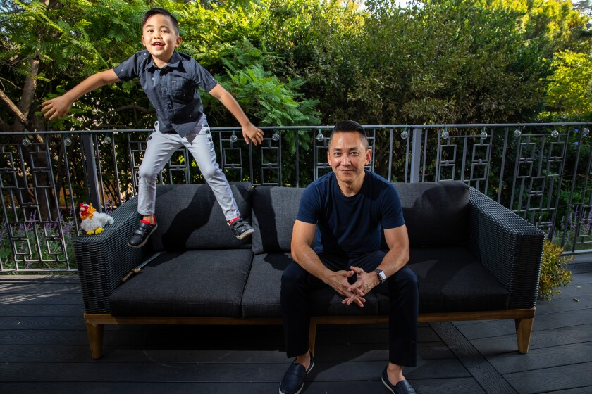 Pulitzer Prize-winning author Viet Thanh Nguyen with his son (and co-author) Ellison in the backyard of their Pasadena home.