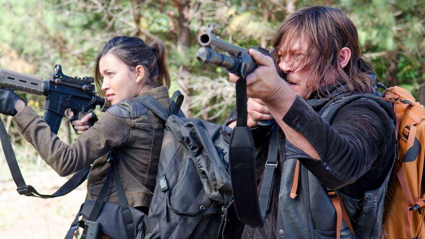 Christian Serratos as Rosita Espinosa and Norman Reedus as Daryl Dixon - The Walking Dead _ Season 6