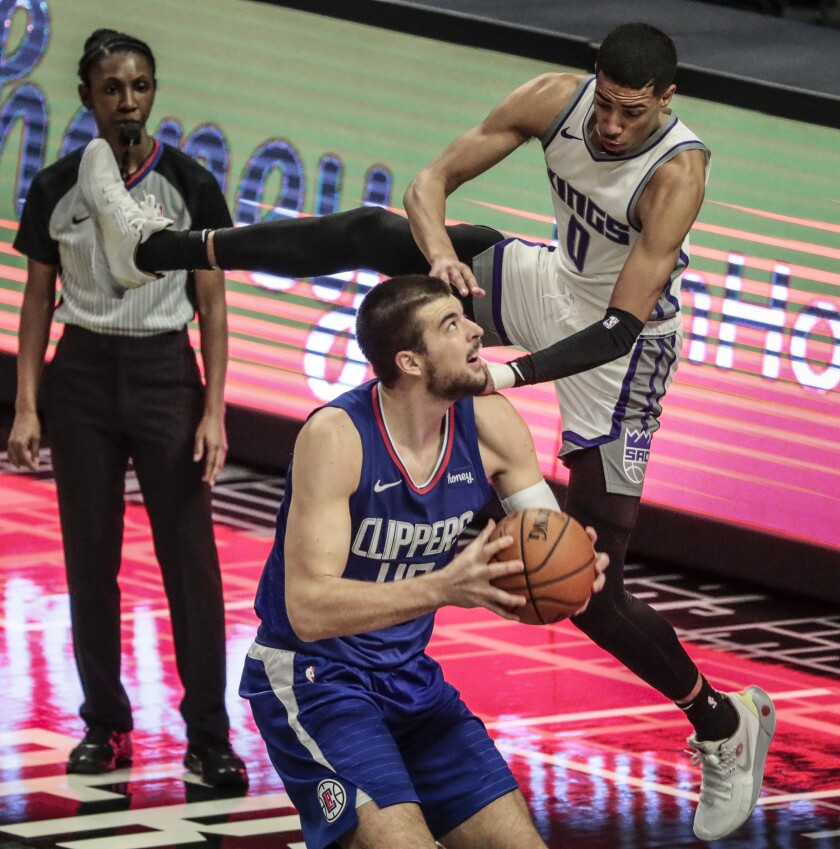 Clippers center Ivica Zubac is fouled by Sacramento Kings guard Tyrese Haliburton on Wednesday at Staples Center.
