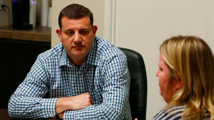 Rep. David Valadao (R-Hanford) meets a constituent during district meetings last month. The last two GOP presidential candidates lost in his district by double digits.