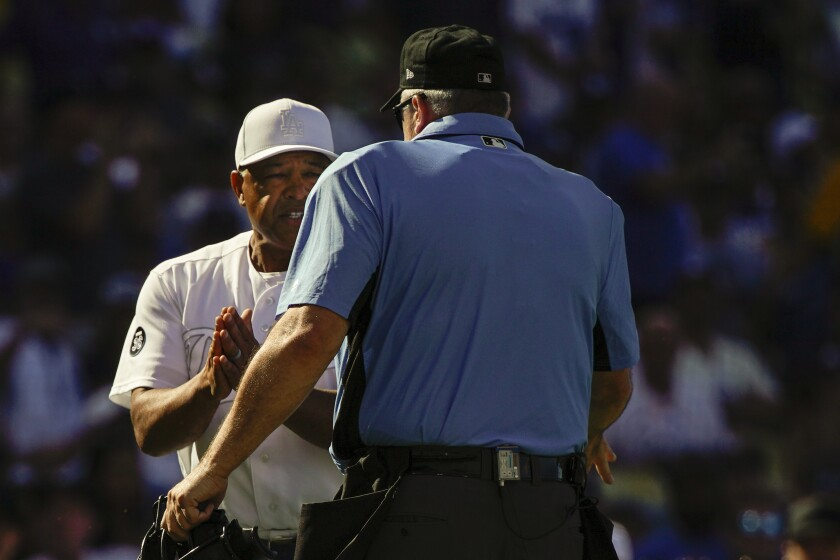 Dodgers manager Dave Roberts talks with the home plate umpire during Sunday's loss to the New York Yankees.