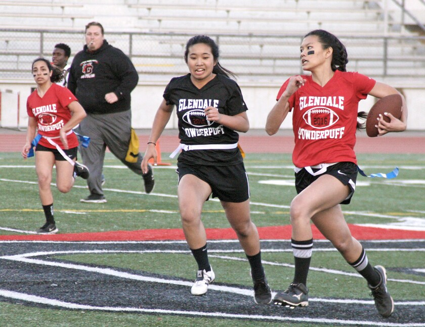 Adel Ortega carries the ball during Glendale High's powder-puff football game