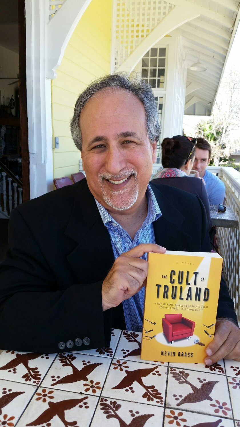 Kevin Brass with his novel, 'The Cult of Truland.'