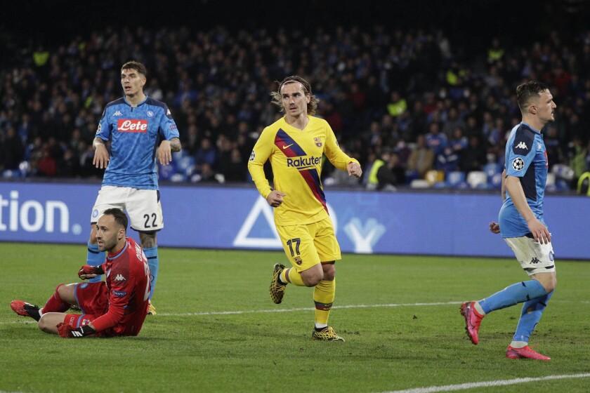 Barcelona's Antoine Griezmann, center, celebrates after scoring against Napoli on Feb. 25.