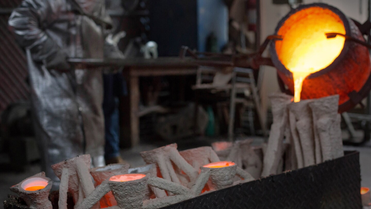 Molten bronze metal is poured into molds in the casting of the solid bronze actor statuette at the American Fine Arts Foundry in Burbank on Tuesday in preparation for the Screen Actors Guild Awards.