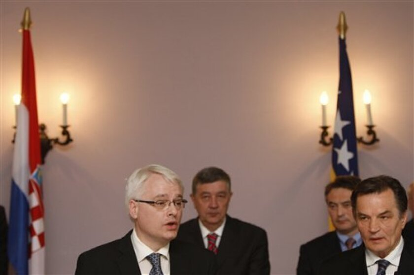 Croatian President Ivo Josipovic,first left, accompanied by members of Bosnian tri partite presidency Haris Silajdzic first right, Nebojsa Radmanovic,back left, and Zeljko Komsic, back right, addresses journalists during an official visit to Bosnia, in Sarajevo, on Wednesday, April 14, 2010. Josipo
