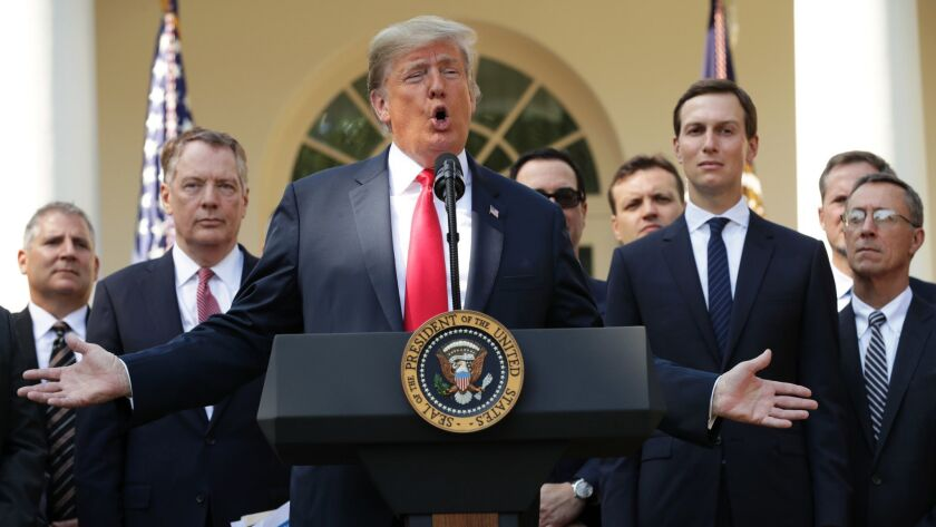 President Trump speaks at a news conference to discuss a revised U.S. trade agreement with Mexico and Canada at the White House on Thursday.