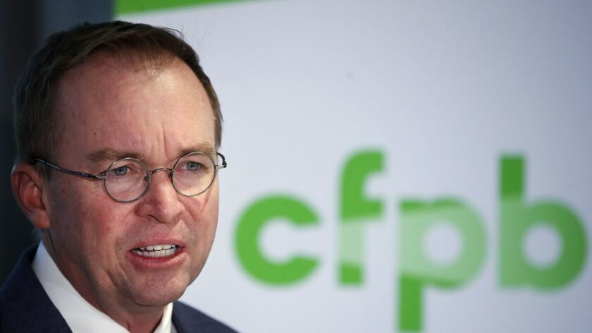 Mick Mulvaney speaks during a news conference Nov. 27 after his first day as acting director of the Consumer Financial Protection Bureau in Washington. Mulvaney has launched a broad review of the bureau's operations and called for reining in its enforcement powers.