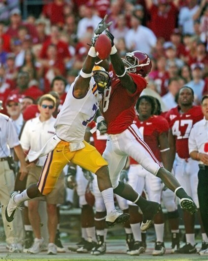 FILE - In this Nov. 7, 2009, file photo, LSU defender Patrick Peterson (7) breaks up a pass intended for Alabama's Julio Jones (8) during the first quarter of an NCAA college football game at Bryant Denny Stadium in Tuscaloosa, Ala. Jones has had huge plays and 100-yard games against LSU each of the past two seasons. As a freshman, he outjumped Peterson for a 24-yard catch in overtime that set up the winning touchdown. LSU plays Alabama on Saturday. (AP Photo/Dave Martin, File)