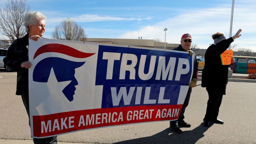 Supporters of President Trump's orders on immigration and refugees rally outside the Farmington Museum at Gateway Park in Farmington, N.M. (Hannah Grover / Associated Press)