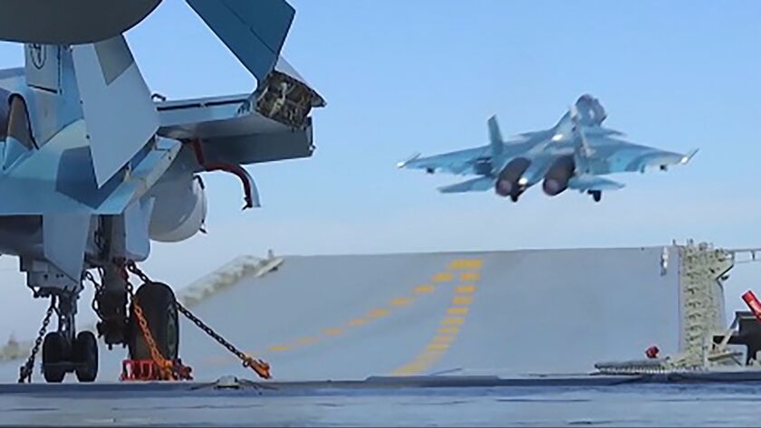 In an image released by the Russian defense ministry, a jet takes off from the aircraft carrier Admiral Kuznetsov in the eastern Mediterranean on a mission against Syrian rebels.