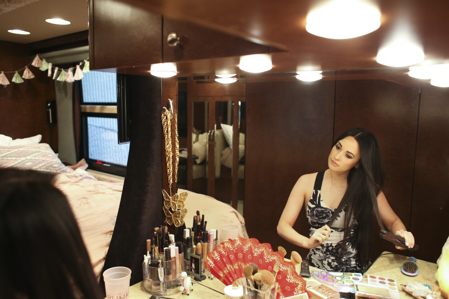 Kacey Musgraves prepares for her show at the U.S. Cellular Center in her tour bus.