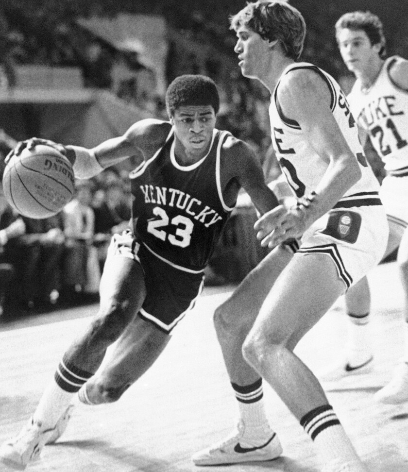 """FILE - University of Kentucky's Dwight Anderson drives past Duke University's Jim Suddath during the first half of an NCAA college basketball game in Springfield, Mass., Nov. 17, 1979. Dwight Anderson, who earned the nickname """"The Blur"""" because of his speed on the court playing basketball at Kentucky and Southern California, has died. He was 59. Anderson died last Saturday, Sept. 5, 2020, in his hometown of Dayton, Ohio, according to USC. The cause was not immediately known.(AP Photo/Paul Benoit, File)"""