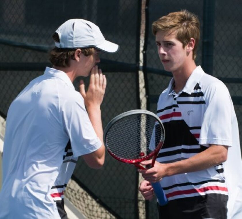 Freshman Riley Vickers and senior captain Colton Kellogg, the No. 1 doubles pair for La Jolla, share a moment of strategy during the playoffs last week.