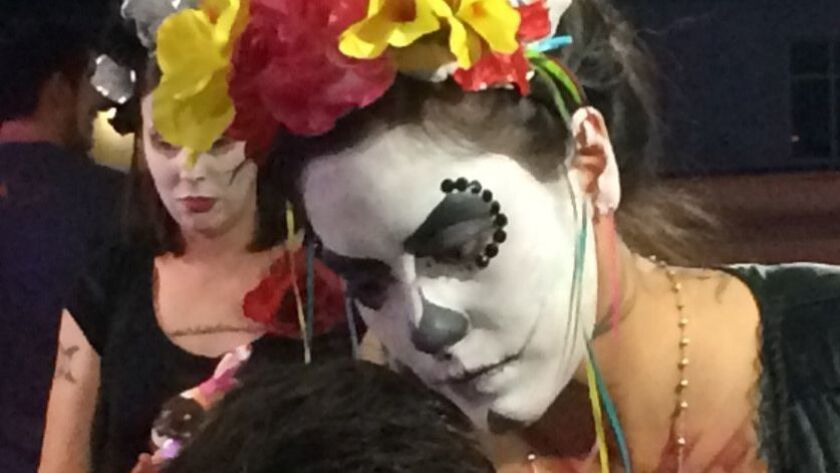 Photos of the parade and face-painting beforehand at the Tucson, Ariz., All Souls Parade on Sunday,