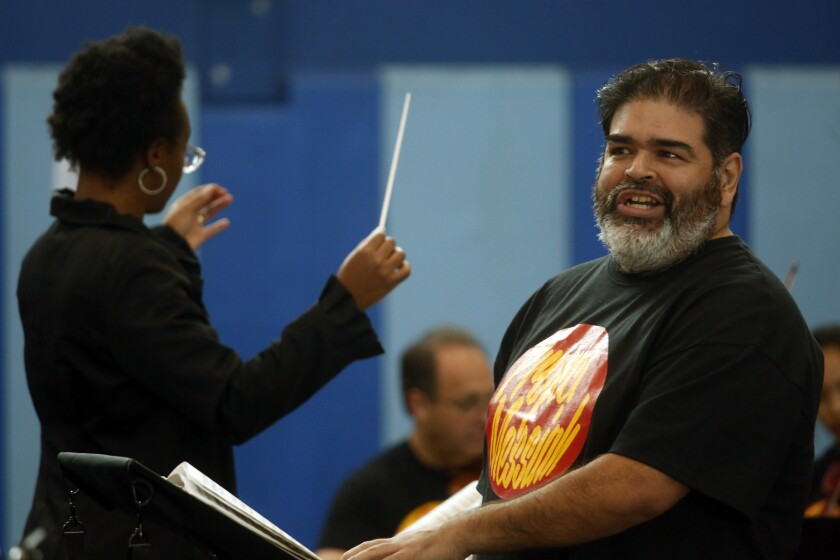 """Tenor and skid-row resident Don Garza with conductor Zanaida Robles in the the Street Symphony """"Messiah Project"""" Friday afternoon at Midnight Mission."""