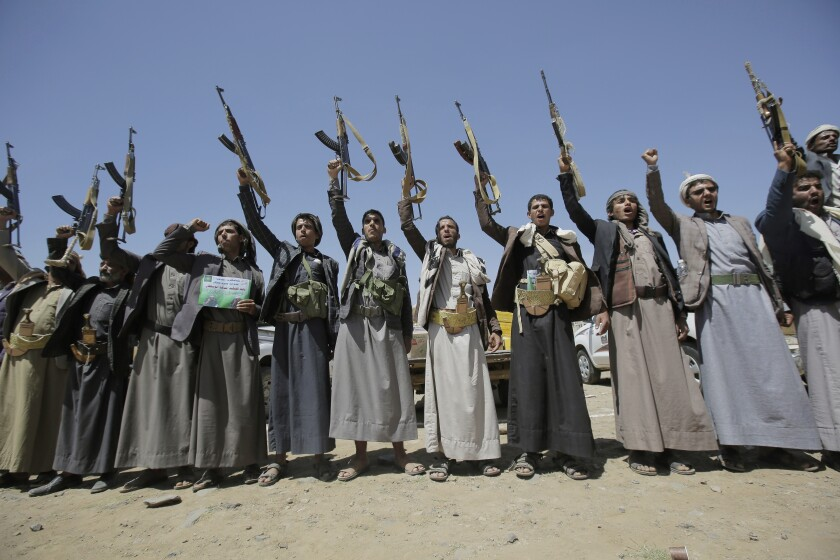 FILE - In this Sept. 21, 2019, file photo, Shiite Houthi tribesmen hold their weapons as they chant slogans during a tribal gathering showing support for the Houthi movement, in Sanaa, Yemen. The United Nations Human Rights Office of the High Commissioner replaced its chief in Yemen, Elobaid Ahmed Elobaid, nearly nine months after the Houthis who control northern Yemen denied him entry, documents dated Tuesday, June 9, 2020 obtained by The Associated Press show. (AP Photo/Hani Mohammed, File)
