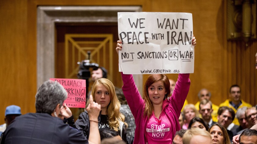 Protesters attend a Senate Foreign Relations Committee business meeting on Capitol Hill in Washington to debate and vote on the Iran Nuclear Agreement Review Act of 2015 last year.