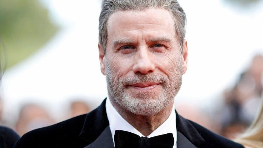 John Travolta arrives Tuesday for the screening of 'Solo: A Star Wars Story' during the 71st annual Cannes Film Festival, in Cannes, France.