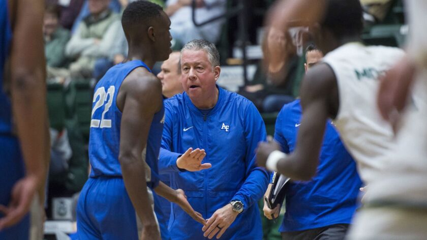 Air Force coach Dave Pilipovich encourages guard Pervis Louder during a timeout in the Falcons' game against Colorado State on Tuesday.