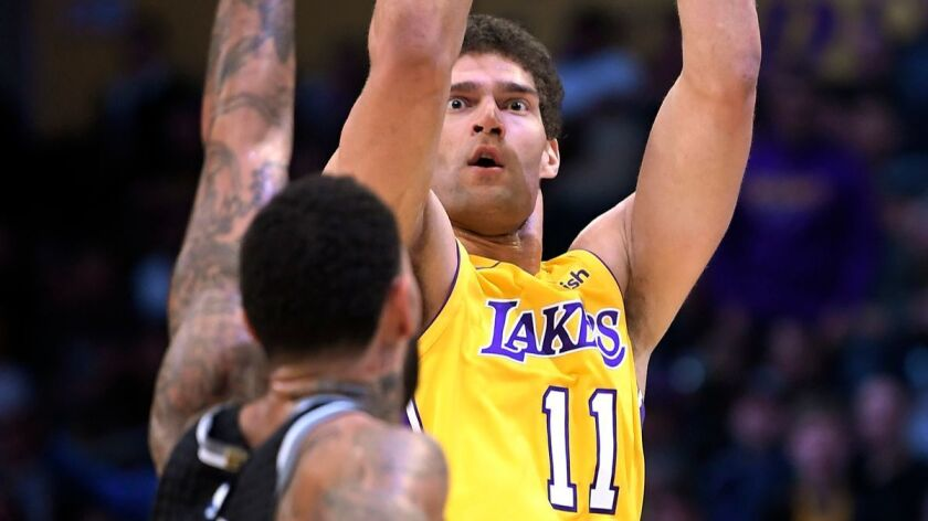 Lakers center Brook Lopez shoots as Sacramento Kings center Willie Cauley-Stein defends during the second half on Tuesday.