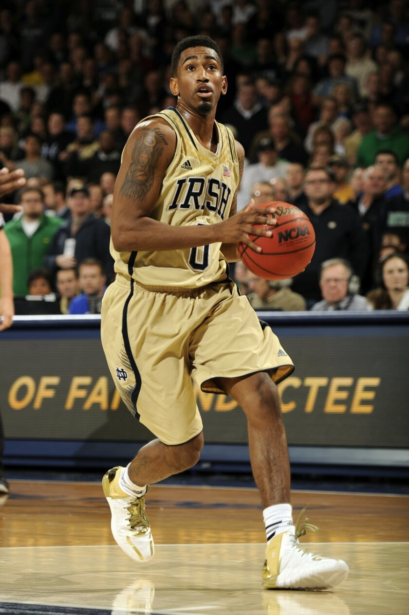 Notre Dame guard Eric Atkins drives the lane against Duke in the second half of an NCAA college basketball game, Saturday, Jan. 4, 2014, in South Bend, Ind. Notre Dame defeated Duke 79-77. Atkins led the Irish scoring 19 points. (AP Photo/Joe Raymond)