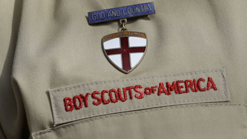 FILE - In this Feb. 4, 2013 file photo, shows a close up detail of a Boy Scout uniform worn during a