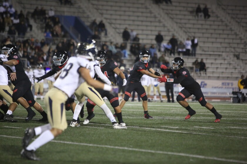 Jakob Galloway and Jake Otto in a football game.
