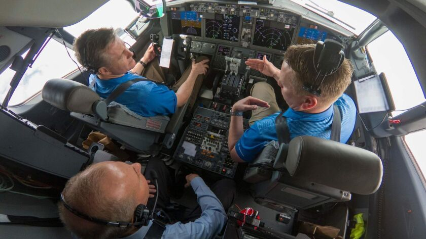 Boeing CEO Dennis Muilenburg, lower left, joins Boeing test pilots for a flight demo of updated software on a 737.