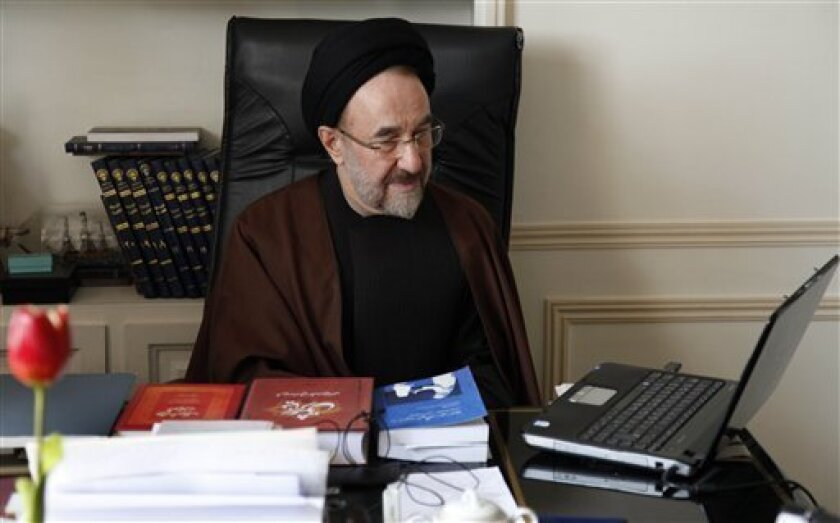 In this undated photo released by office of former Iranian President Mohammad Khatami, Mohammad Khatami, watches a video on his laptop, at his office, in Tehran, Iran. Many reformists are expected to sit out the June 14 voting in a silent protest over the crackdowns that have left them leaderless a