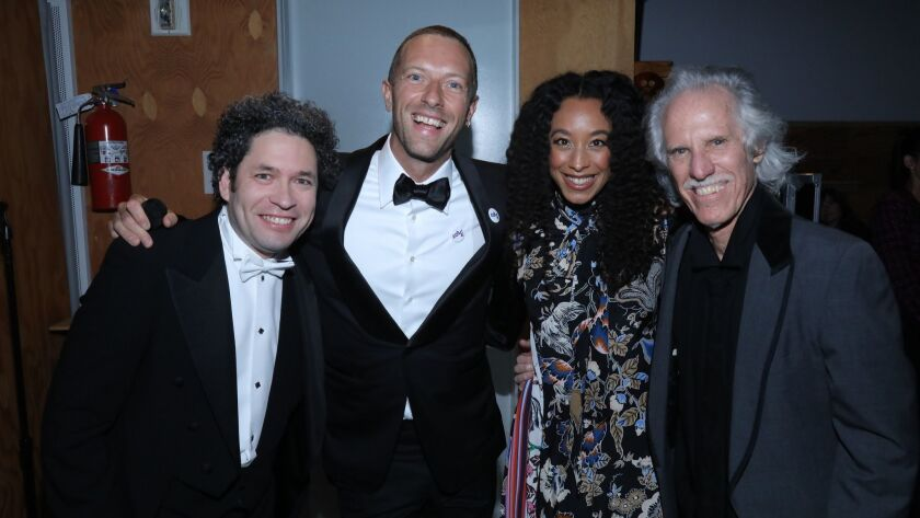Before L.A. Phil's festive gala, Gustavo Dudamel, left, Chris Martin, Corinne Bailey Rae and John Densmore performed onstage at Walt Disney Concert Hall.