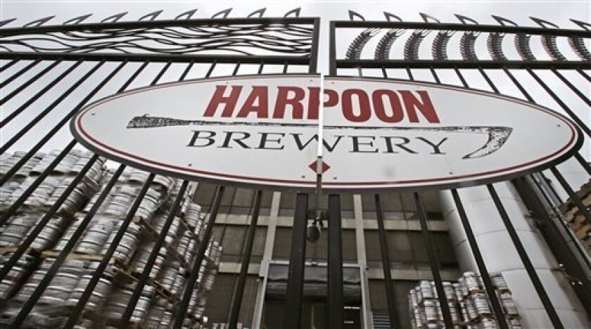 In this July 1, 2013 photo, aluminum beer barrels are stored in the courtyard at the Harpoon Brewery in the Seaport District of Boston. The neighborhood around the brewery is transforming from a waterfront industrial area to one that hosts upscale restaurants, luxury hotels and an art museum. (AP Photo/Charles Krupa)