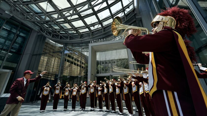 The USC marching band performs under the skylight during the grand opening ceremony for the Wilshire