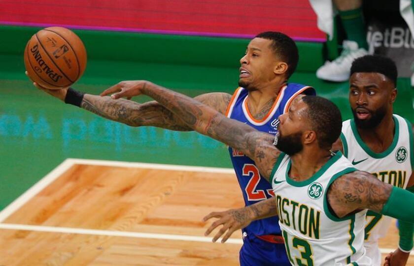 Boston Celtics Marcus Morris (C) fouls New York Knicks Trey Burke (L) as the Celtics Jaylen Brown (R) defends during the second half at the TD Garden in Boston, Massachusetts, USA, 21 November 2018. EPA-EFE/CJ GUNTHER