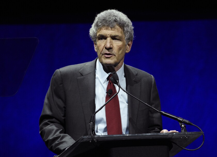FILE - Alan Horn, chairman of The Walt Disney Studios, addresses the audience during the Walt Disney Studios Motion Pictures presentation at CinemaCon 2019 on April 3, 2019, in Las Vegas. Horn, the film executive who helped turn Walt Disney Studios into the most powerful movie studios in Hollywood, is retiring. Disney announced Monday that Horn, 78, will step down at the end of the year. (Photo by Chris Pizzello/Invision/AP, File)