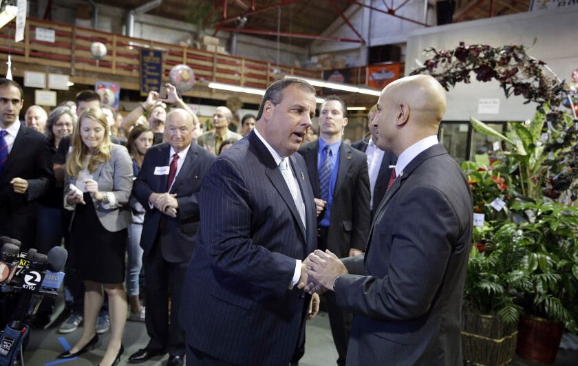 New Jersey Gov. Chris Christie shakes hands with GOP gubernatorial candidate Neel Kashkari in June 2014 in San Francisco.