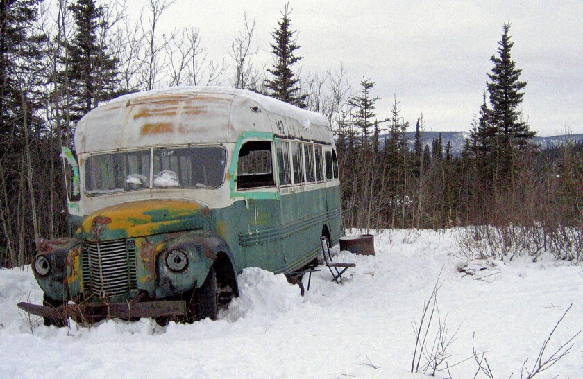 FILE - In this March 21, 2006, file photo, is the abandoned bus where Christopher McCandless starved to death in 1992 near Healy, Alaska. The bus that people sometimes embarked on deadly pilgrimages to Alaska's backcountry to visit can now safely be viewed at the University of Alaska Fairbanks while it undergoes preservation work. The bus was moved to the university's engineering facility in early Oct. 2021, while it's being prepared for outdoor display at the Museum of the North, Fairbanks television station KTVF reported. (AP Photo/Jillian Rogers, File )