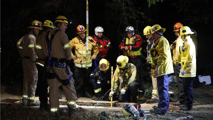 Firefighters search for a 13-year-old boy who fell through a drainage pipe near the L.A. River at the 134 and 5 Freeway interchange.
